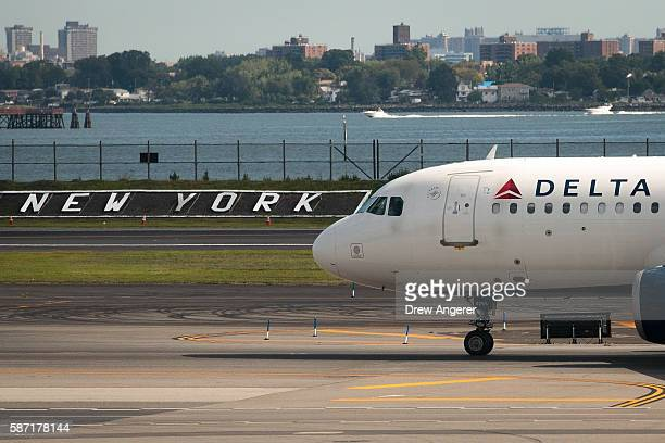Delta jet taxis on the tarmac at LaGuardia Airport August 8 2016 in the Queens borough of New York City Delta flights around the globe were grounded...