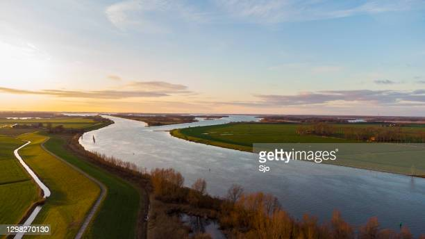 delta of the river ijssel in overijssel during sunset after a beautiful winter day - overijssel stock pictures, royalty-free photos & images
