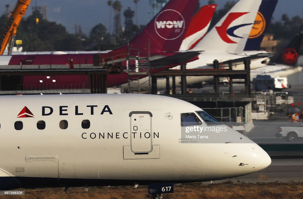 A Delta plane taxis at Los Angeles International Airport on July 12, 2018 in Los Angeles, California. Delta announced today that it will increase fares by reducing the supply of seats in an effort to offset higher fuel prices.