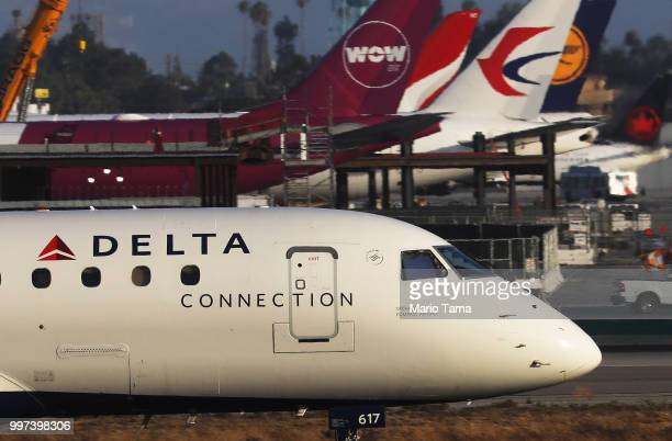 Delta plane taxis at Los Angeles International Airport on July 12 2018 in Los Angeles California Delta announced today that it will increase fares by...