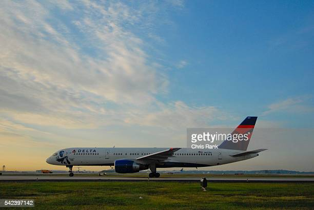 A Delta plane with company's new logo taxis down the runway at HartsfieldJackson International Airport in Atlanta
