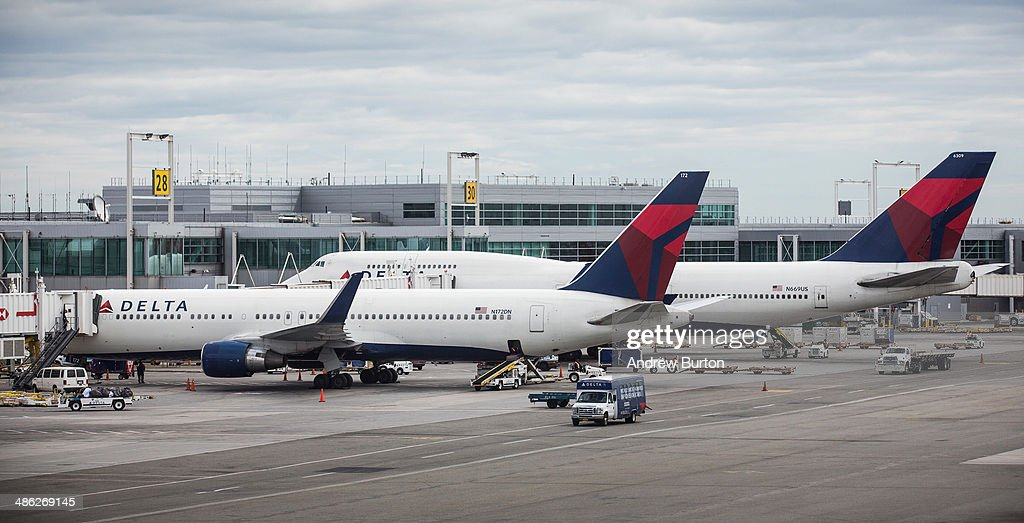 Delta planes sit at their gates at John F. Kennedy Airport on April 23, 2014 in the Queens borough of New York City. Delta released higher-than-expected quarterly earnings today, causing its stock to rise 5%.