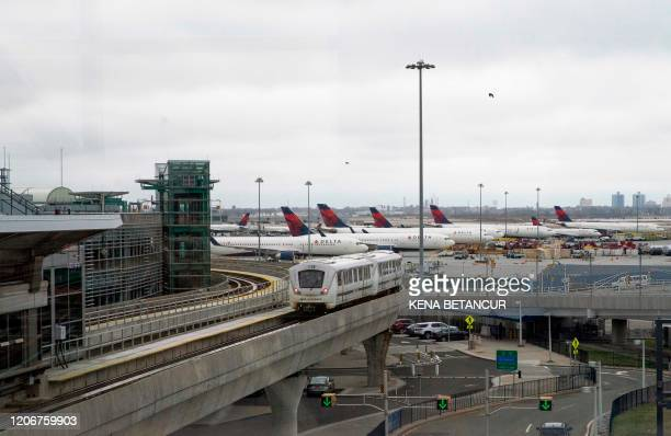 Delta planes sit on the tarmac at John F. Kennedy International Airport on March 12, 2020 in New York City. - US President Donald Trump announced a...