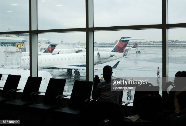 Delta planes sit on the tarmac at LaGuardia Airport on the day before Thanksgiving, the nation's busiest travel day on November 22, 2017 in New York...