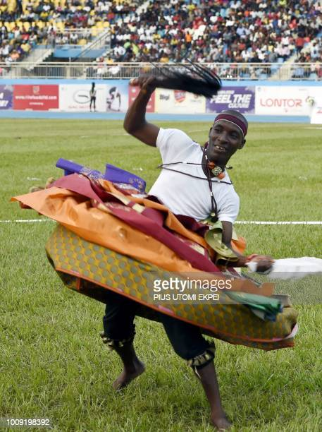 A Delta State cultural member dances during the opening of the 21st African Senior Athletics Championships at the Stephen Keshi Stadium in Asaba...