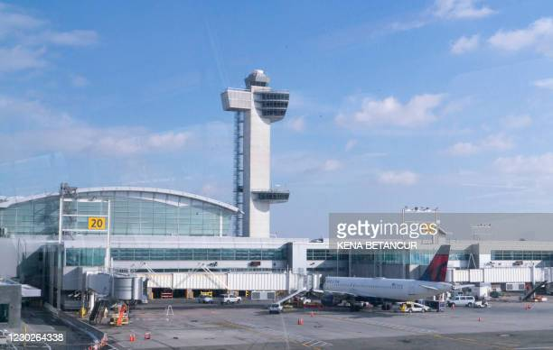 Deltal planes are seen at terminal 4 at JFK International airport at JFK International airport in New York on December 22, 2020. - Passengers flying...