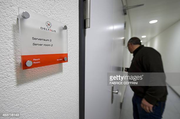 Deltalis' Patrick Mueller opens a door at the Deltalis Swiss Mountain Data Center a former Swiss Army bunker built in the Alps during the Cold War on...