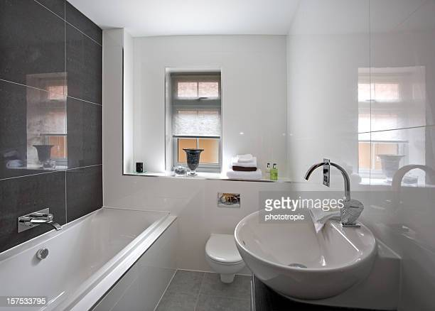 deluxe bathroom in a new home - bathroom stock photos and pictures