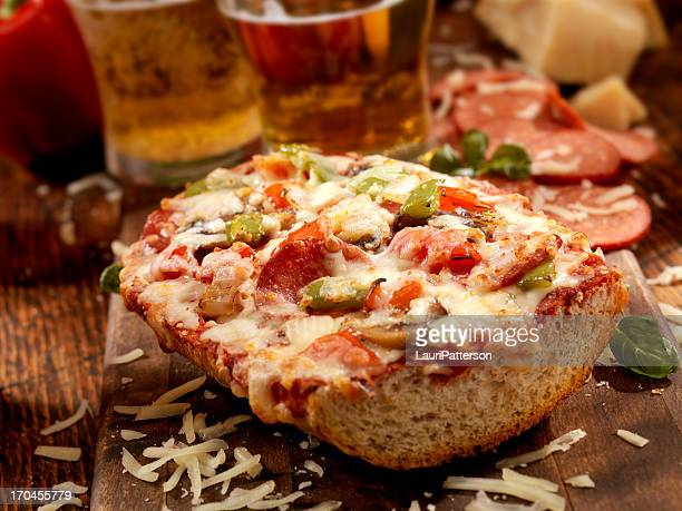 deluxe french bread pizza - baguette stock pictures, royalty-free photos & images