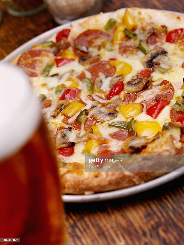 Deluxe Pizza and a Beer : Stock Photo
