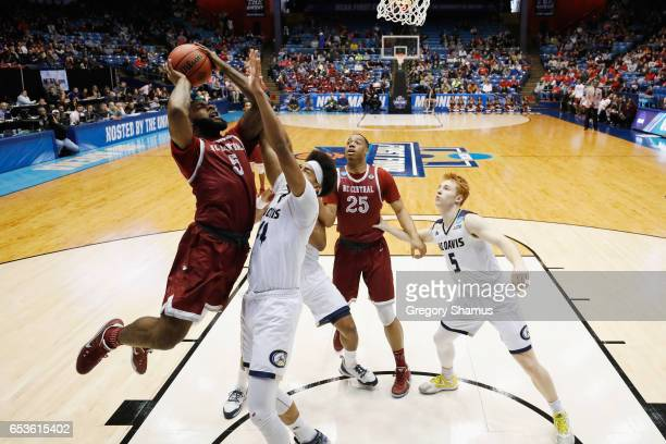 Del'Vin Dickerson of the North Carolina Central Eagles drives to the basket against the UC Davis Aggies in the first half during the First Four game...