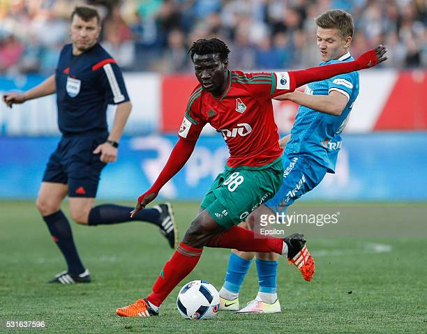 Delvin N'Dinga of FC Lokomotiv Moscow and Oleg Shatov of FC Zenit St Petersburg vie for the ball during the Russian Football League match between FC...