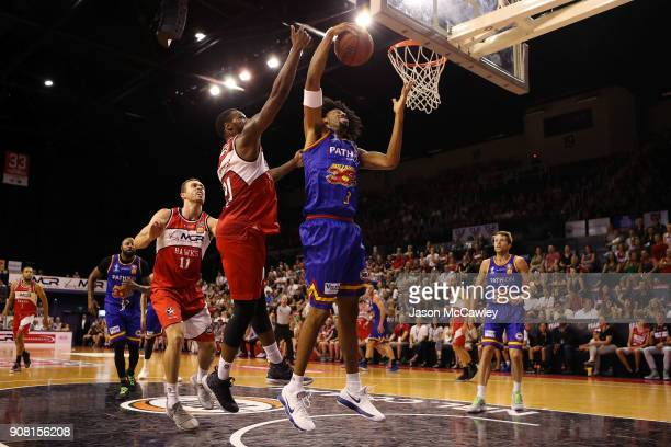 Delvon Johnson of the Hawks and Jason Childress of the 36ers contest a rebound during the round 15 NBL match between the Illawarra Hawks and Adelaide...