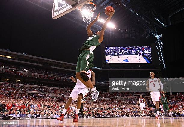Delvon Roe of the Michigan State Spartans drives for a shot attempt against the Louisville Cardinals during the fourth round of the NCAA Division I...