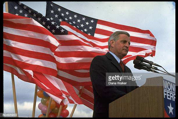 Dem pres cand exVP Walter Mondale poised at podium add ressing endofcampaign rally framed by flags flapping in breeze