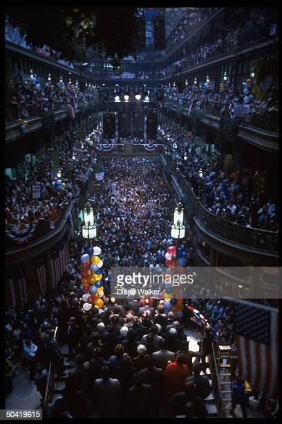 Dem Pres cand Walter Mondale addressing huge crowd filling Portside Festival Marketplace campaigning in Toledo OH