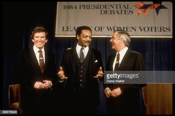 Dem presidential hopefuls Gary Hart Jesse Jackson Walter Mondale smiling onstage together after a primary debate before the League of Women Voters