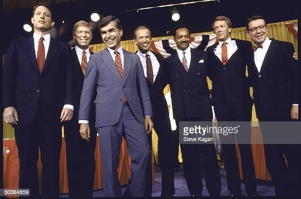 Dem presidential hopefuls standing in row looking like friendly foes including Sen Paul Simon Gov Bruce Babbitt Rev Jesse Jackson Sen Joseph Biden...