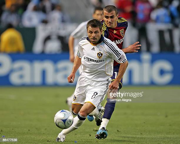 Dema Kovalenko of the Los Angeles Galaxy controls the ball against Yura Movsisyan of Real Salt Lake during their MLS game at The Home Depot Center on...