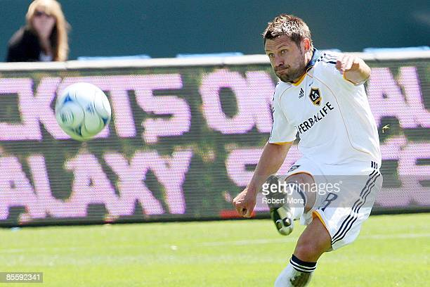 Dema Kovalenko of the Los Angeles Galaxy makes a pass up the field against the defense of DC United during the MLS game at Home Depot Center on March...