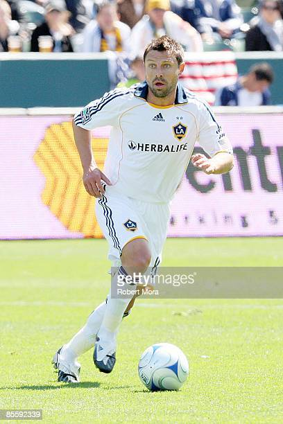 Dema Kovalenko of the Los Angeles Galaxy moves the ball up the field against the defense of DC United during the MLS game at Home Depot Center on...