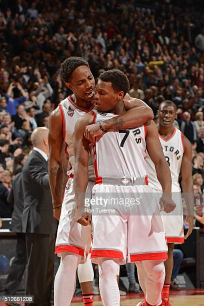 DeMar DeRozan and Kyle Lowry of the Toronto Raptors celebrate after beating the Cleveland Cavaliers on February 26 2016 at Air Canada Centre in...