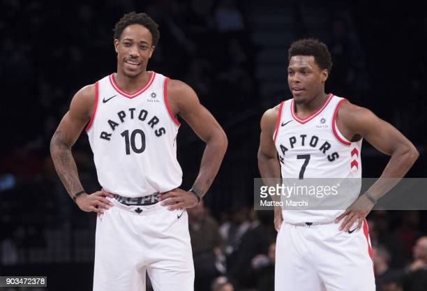 DeMar DeRozan and Kyle Lowry of the Toronto Raptors during the game against the Brooklyn Nets at Barclays Center on January 08 2018 in Brooklyn New...
