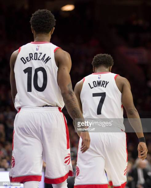 DeMar DeRozan and Kyle Lowry of the Toronto Raptors in action against the Philadelphia 76ers at the Wells Fargo Center on December 21 2017 in...