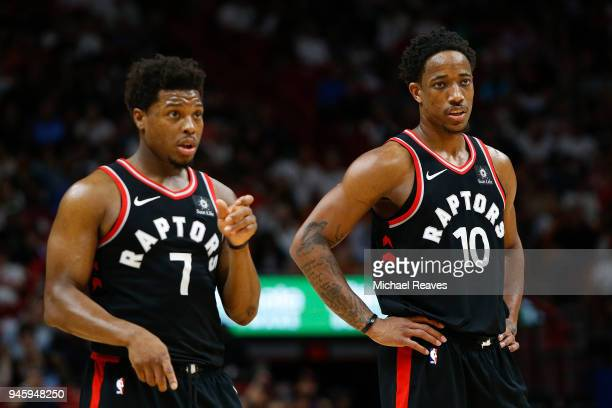 DeMar DeRozan and Kyle Lowry of the Toronto Raptors look on against the Miami Heat during the second half at American Airlines Arena on April 11 2018...