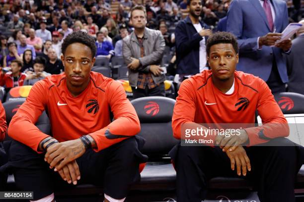 DeMar DeRozan and Kyle Lowry of the Toronto Raptors look on from the sideline prior to the start of the game against the Philadelphia 76ers on...