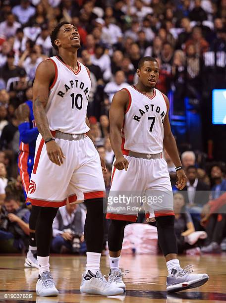 DeMar DeRozan and Kyle Lowry of the Toronto Raptors look to the scoreboard during an NBA game against the Detroit Pistons at Air Canada Centre on...