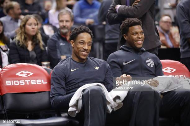 DeMar DeRozan and Kyle Lowry of the Toronto Raptors looks on before the game against the Los Angeles Lakers on January 28 2018 at the Air Canada...