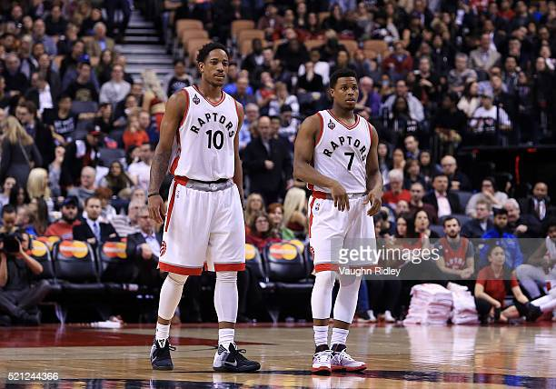 DeMar DeRozan and Kyle Lowry of the Toronto Raptors looks on during the second half of an NBA game against the Philadelphia 76ers at the Air Canada...