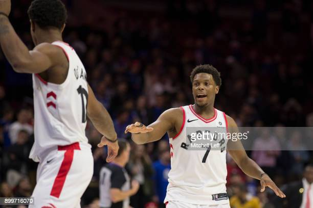 DeMar DeRozan and Kyle Lowry of the Toronto Raptors react against the Philadelphia 76ers at the Wells Fargo Center on December 21 2017 in...