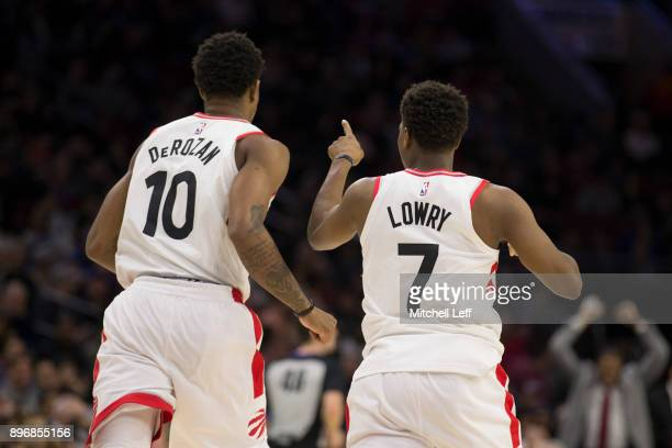 DeMar DeRozan and Kyle Lowry of the Toronto Raptors run down the court in the third quarter against the Philadelphia 76ers at the Wells Fargo Center...