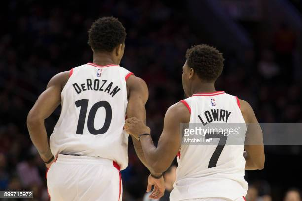DeMar DeRozan and Kyle Lowry of the Toronto Raptors run down the court against the Philadelphia 76ers at the Wells Fargo Center on December 21 2017...