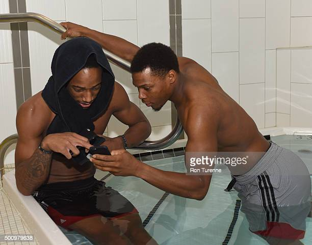DeMar DeRozan and Kyle Lowry of the Toronto Raptors sit in a pool after an open practice on December 6 2015 at the Air Canada Centre in Toronto...