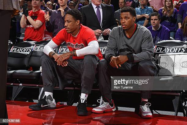 DeMar DeRozan and Kyle Lowry of the Toronto Raptors sit on the bench before Game Two of the Eastern Conference Quarterfinals against the Indiana...