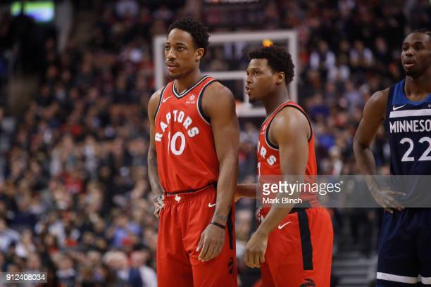 DeMar DeRozan and Kyle Lowry of the Toronto Raptors speak during the game against the Minnesota Timberwolves on January 30 2018 at the Air Canada...