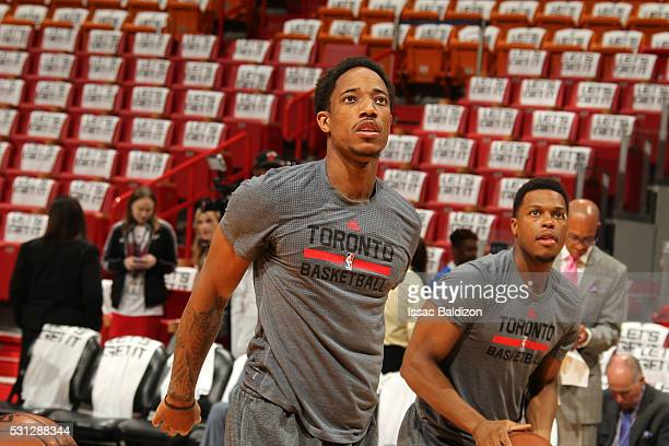 DeMar DeRozan and Kyle Lowry of the Toronto Raptors warm up before the game against the Miami Heat in Game Six of the Eastern Conference Semifinals...