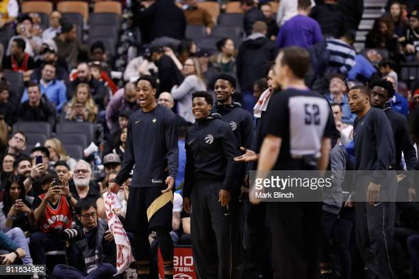 DeMar DeRozan and Kyle Lowry of the Toronto Raptors with their teammates react to a play against the Los Angeles Lakers on January 28 2018 at the Air...
