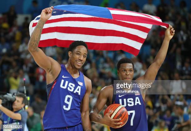 Demar DeRozan and Kyle Lowry of the USA celebrate after defeating Serbia during the Basketball Men's Gold Medal Game during the Rio 2016 Olympic...