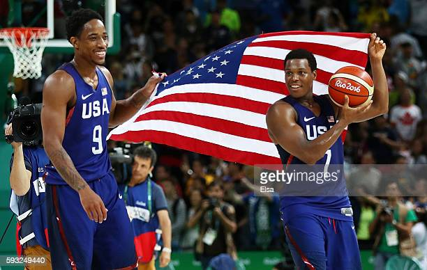 Demar DeRozan and Kyle Lowry of United States celebrate afer defeating Serbia during the Men's Gold medal game on Day 16 of the Rio 2016 Olympic...