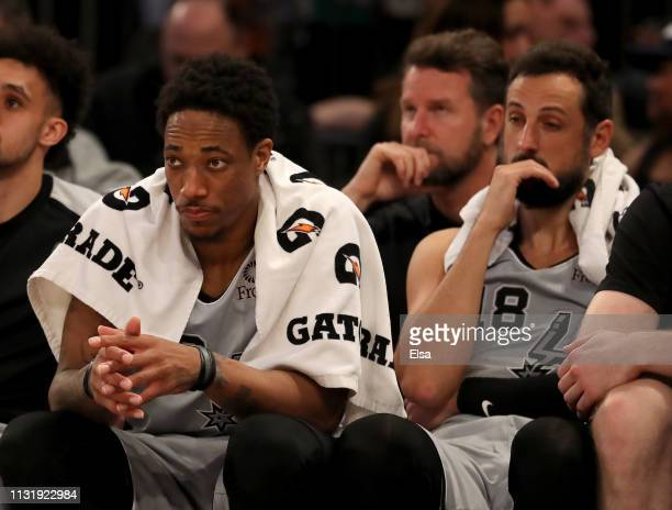 DeMar DeRozan and Marco Belinelli of the San Antonio Spurs react on the bench as the New York Knicks win the game at Madison Square Garden on...