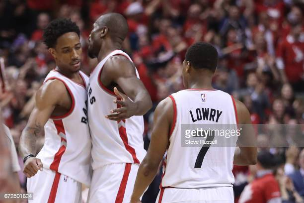 TORONTO APRIL 24 DeMar DeRozan chest bumps with Serge Ibaka after hitting a three as the Toronto Raptors beat Milwaukee Bucks in game 5 of their...