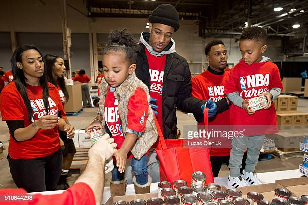 DeMar DeRozan his wife Kiara and his 2yearold daughter Diar joined Kyle Lowry and his 4yearold son Karter at the Enercare Centre in Toronto to fill...