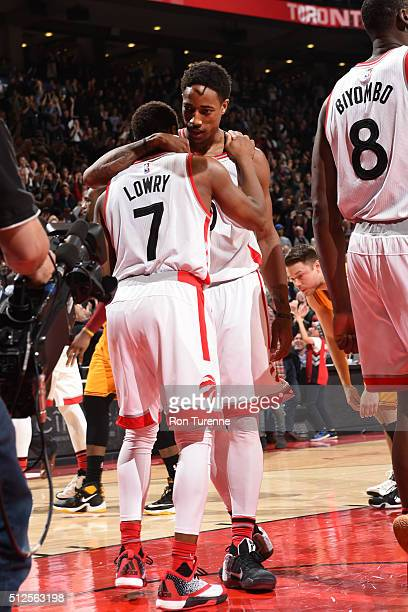 DeMar DeRozan hugs teammate Kyle Lowry of the Toronto Raptors after the win against the Cleveland Cavaliers during the game on February 26 2016 at...