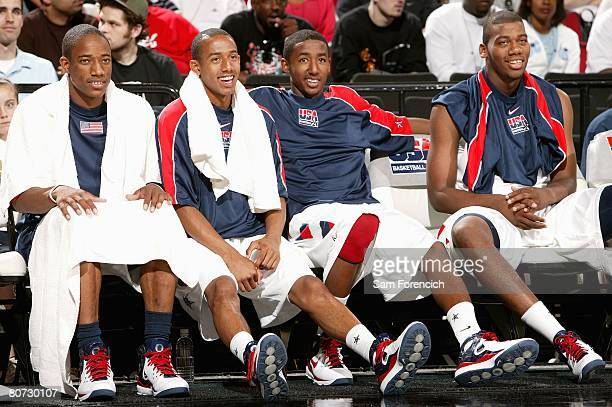 Demar DeRozan Jerime Anderson Malcolm Lee and Greg Monroe of Team USA sit on the bench in the game against Team World during the Nike Hoop Summit on...