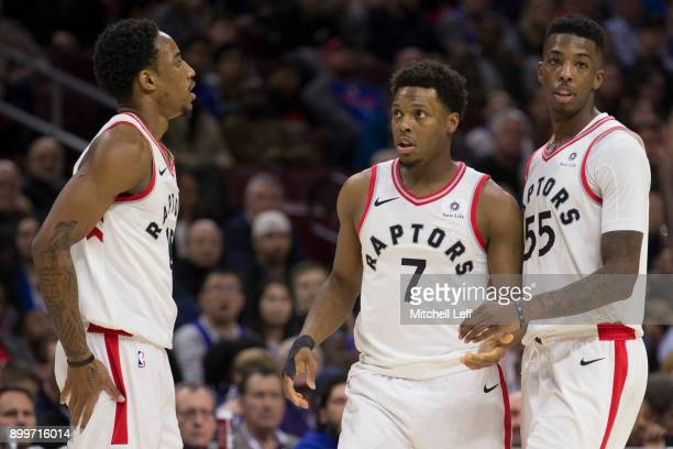 DeMar DeRozan Kyle Lowry and Delon Wright of the Toronto Raptors huddle against the Philadelphia 76ers at the Wells Fargo Center on December 21 2017...