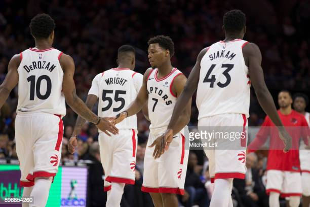 DeMar DeRozan Kyle Lowry Delon Wright and Pascal Siakam of the Toronto Raptors react during a timeout in the third quarter against the Philadelphia...